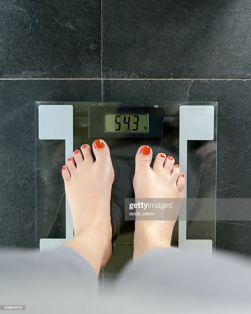 woman on scale : Stock Photo
