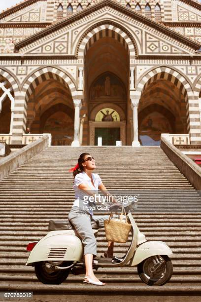 Woman on scooter outside Amalfi Cathederal