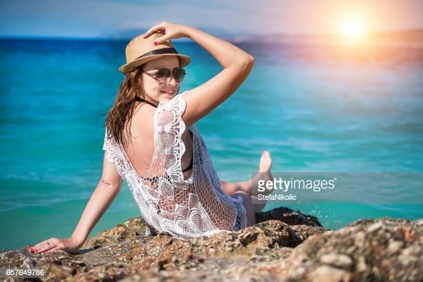 woman on sea rock