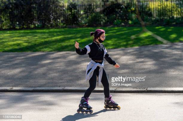 Woman on skates seen in Londons Hyde Park.