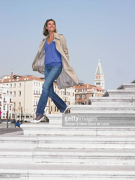 Woman on stairs by the marina