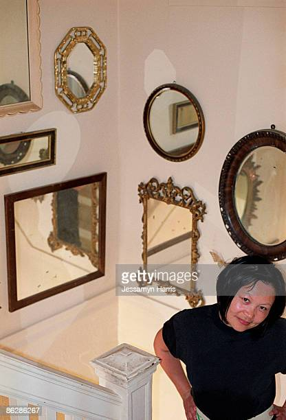 woman on stairs with mirrors - jessamyn harris stock pictures, royalty-free photos & images
