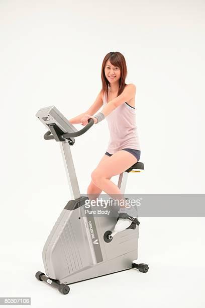 Woman on stationary bike, smiling