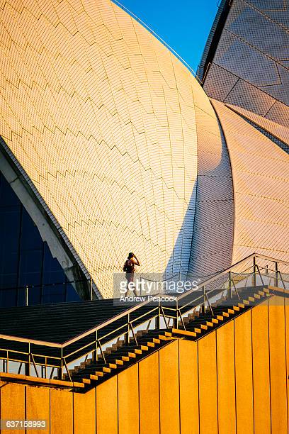 a woman on steps, sydney opera house - international landmark stock pictures, royalty-free photos & images