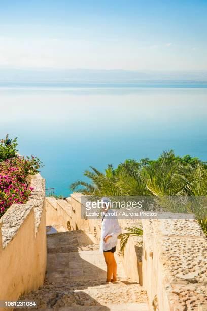 Woman on stone staircase leading to Dead Sea, Amman, Jordan