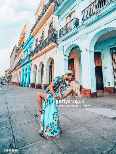 woman on street amidst buildings in city - havana stock pictures, royalty-free photos & images