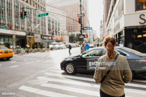 woman on street - downtown district stock pictures, royalty-free photos & images