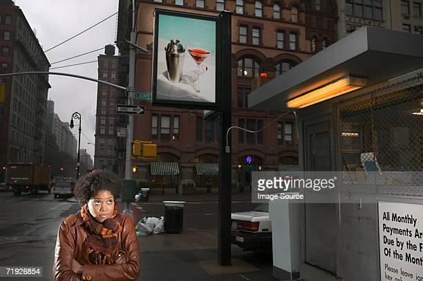 Woman on street with billboard
