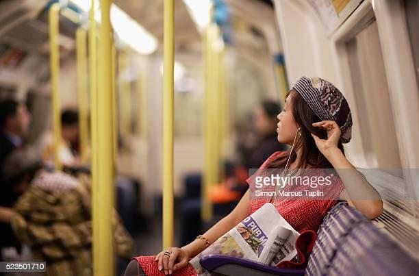 woman on subway - u bahnzug stock-fotos und bilder