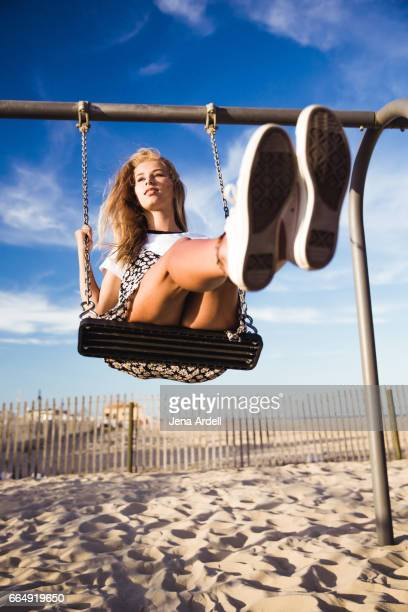 Woman On Swing At Beach