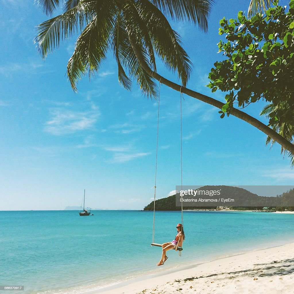 Woman On Swing At Calm Beach : Stock Photo