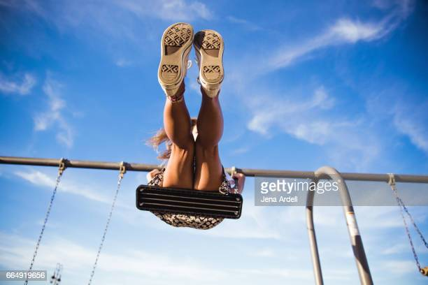 woman on swing - blue shorts stock pictures, royalty-free photos & images