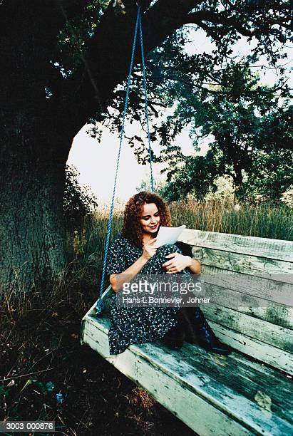 Woman on Swing Reading