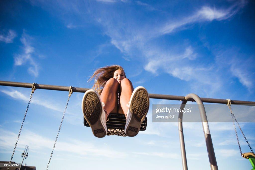 Woman On Swing Set : Stock Photo