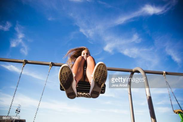 Woman On Swing Set