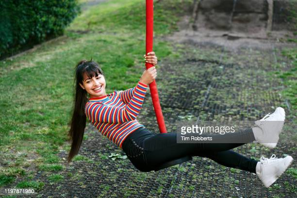 woman on swing slide - latin american and hispanic stock pictures, royalty-free photos & images