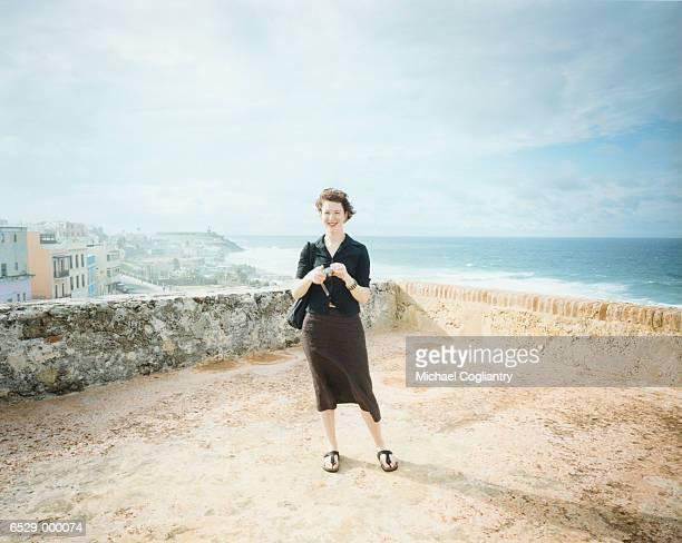 Woman on Terrace near Sea
