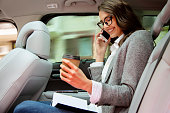 woman back seat car shallow dof