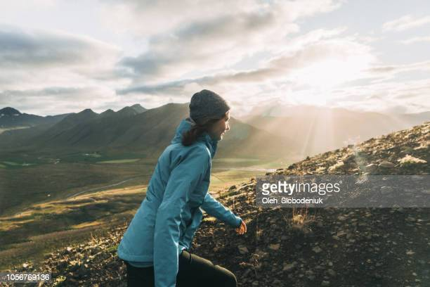 woman on the background of volcanic landscape - active volcano stock pictures, royalty-free photos & images