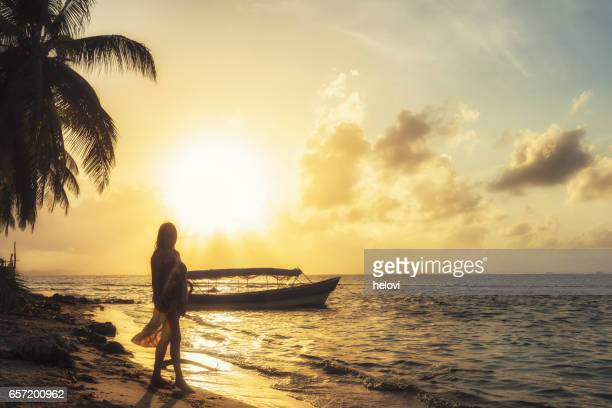 woman on the beach against sunset - hot women on boats stock pictures, royalty-free photos & images