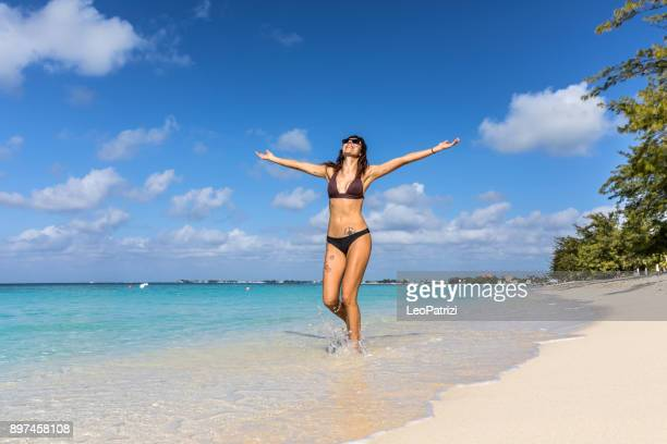 woman on the beach - amazing vacation in wintertime in the caribbean sea - cayman islands - mid adult stock pictures, royalty-free photos & images