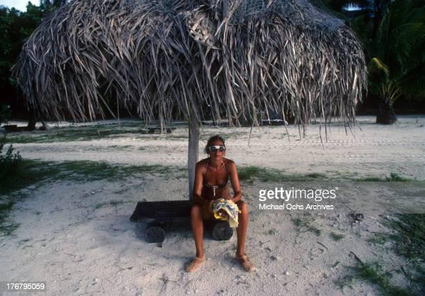 A woman on the beach in May 1980 on Tetiaroa Island