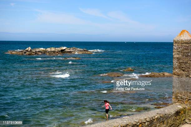 a woman on the beach of barfleur, normandy region, france - feifei cui paoluzzo stock pictures, royalty-free photos & images