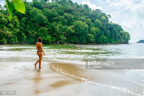 woman on the beach of manuel antonio, costa rica - central america stock pictures, royalty-free photos & images