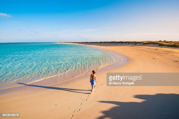 Woman on the beach. Osprey Bay, Western Australia.