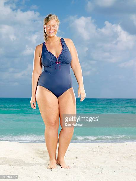 woman on the beach - swimwear stock photos and pictures
