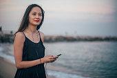 one woman standing alone beach sea