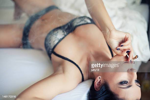 woman on the bed - weed stock photos and pictures