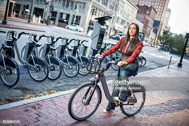woman on the bike in city - massachusetts stock pictures, royalty-free photos & images
