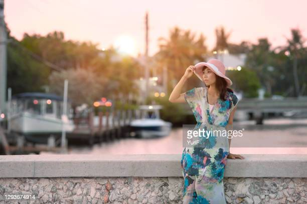 woman on the bridge at sunset - long dress stock pictures, royalty-free photos & images