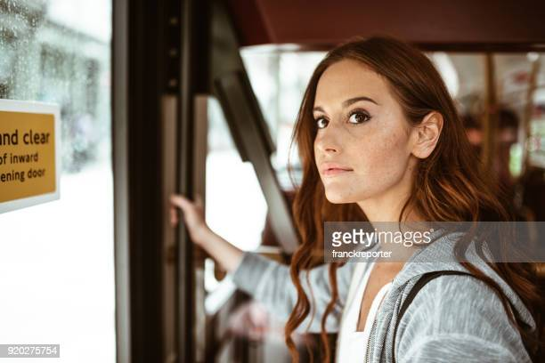 woman on the bus in london - rush hour stock pictures, royalty-free photos & images