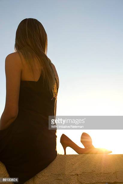 woman on the edge of a building at sunset, montevideo, uruguay - after party stock pictures, royalty-free photos & images