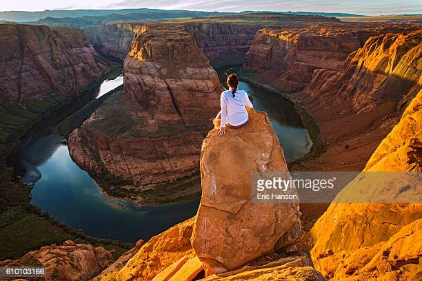 woman on the edge of horseshoe bend - arizona stock photos and pictures