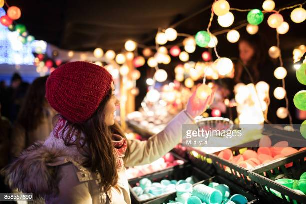 woman on the festive christmas market - brussels capital region stock pictures, royalty-free photos & images