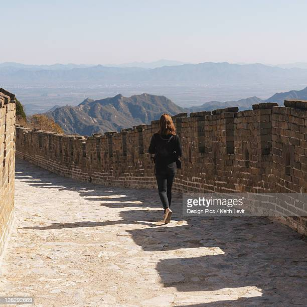 woman on the mutianyu section of the great wall of china