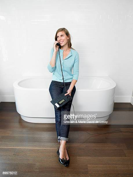 Woman on the phone in bathroom