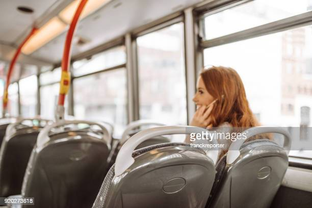 woman on the phone sitting on the bus