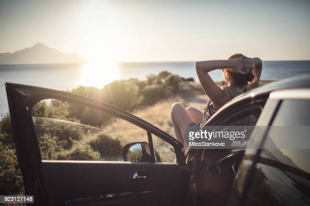 woman on the road trip - vacations stock pictures, royalty-free photos & images