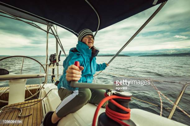 woman on the sailing yacht - navigational equipment stock pictures, royalty-free photos & images