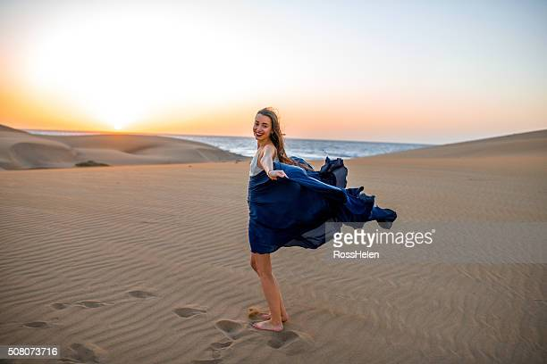 woman on the sand dunes - skirt blowing stock photos and pictures