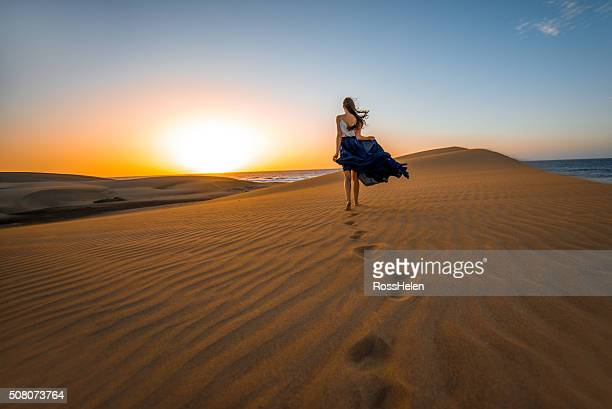 Woman on the sand dunes