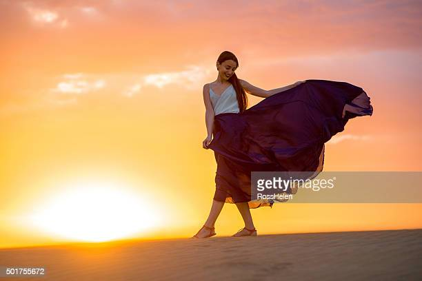 Woman on the sandy dunes