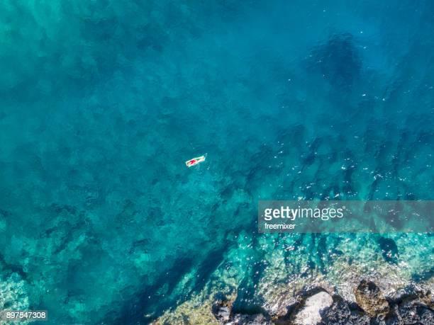 Femme sur la mer