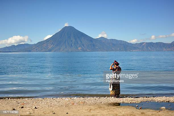 woman on the shores of lake atitlan - guatemala stock pictures, royalty-free photos & images