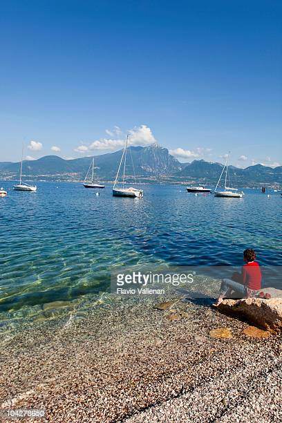 Woman on the shores of Lake Garda, Italy