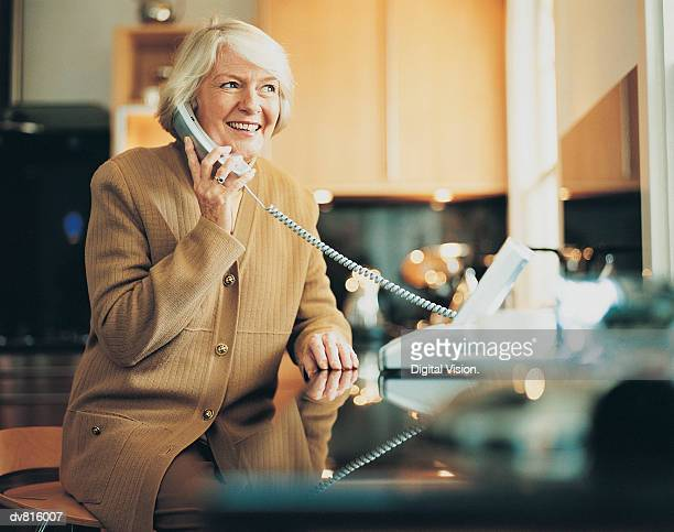 woman on the telephone - landline phone stock pictures, royalty-free photos & images